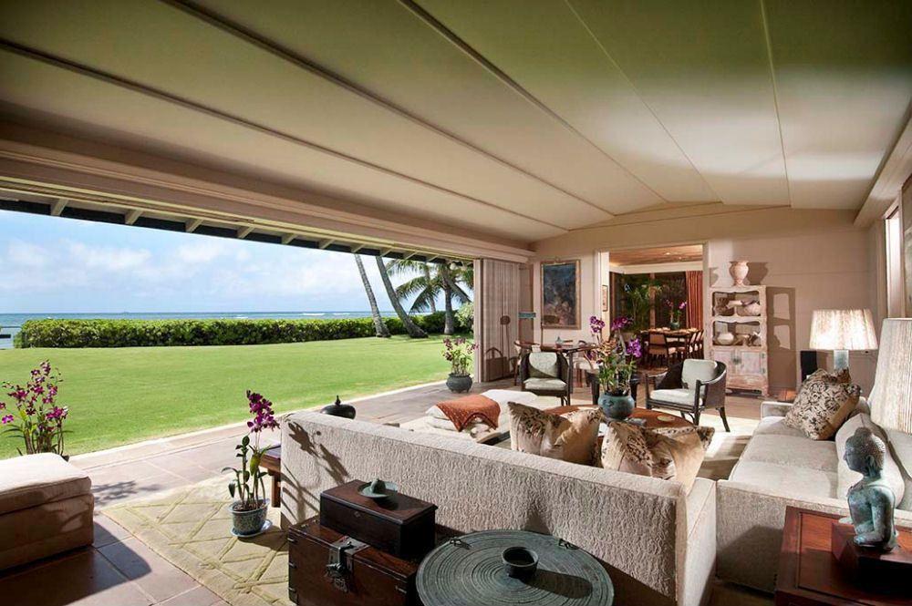 Tropical Living Room with sandstone tile floors in Honolulu, HI - living room hutch