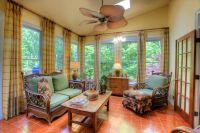 Tropical Living Room with flush light & terracotta tile ...