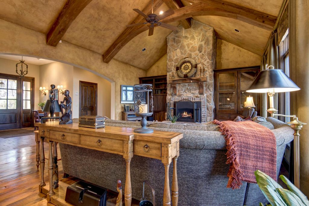 Rustic Living Room with Cathedral ceiling & Hardwood