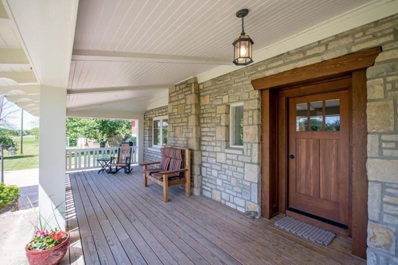 Craftsman front door with exterior stone floors amp glass