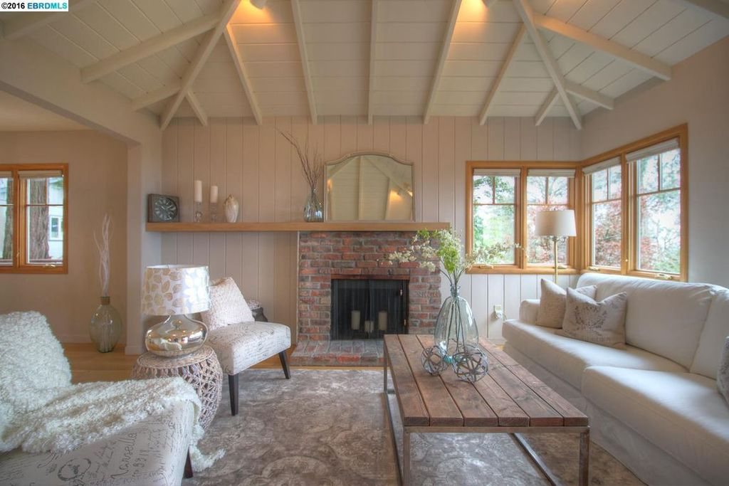 Cottage Living Room with Carpet & Cathedral ceiling in