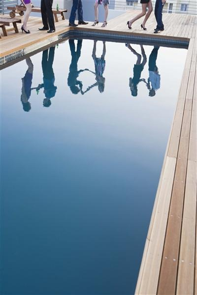 Poolside Party with Reflection in Pool