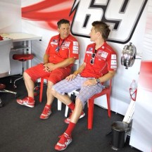 Alfredo and NH69 sitting in the box having a friendly chat before a team meeting