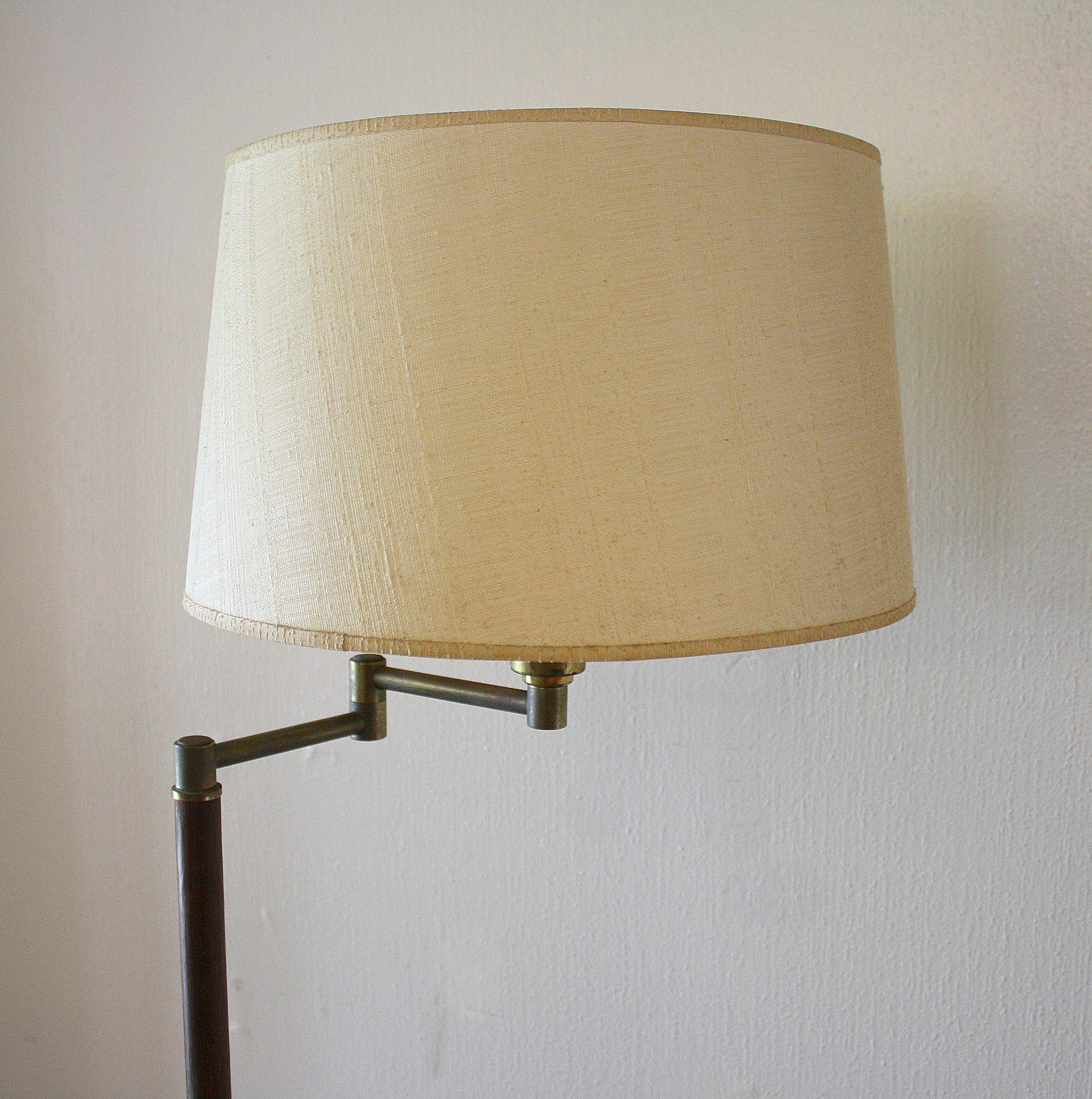 These are two mid century modern swing arm floor lamps they have wood