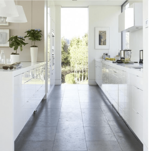 white galley style kitchen feels large open due crisp white white wooden galley kitchen small marble top kitchen island