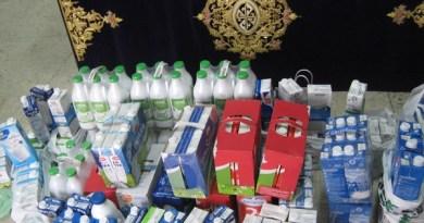 La Hermandad reparte los litros de leche donados en Cuaresma