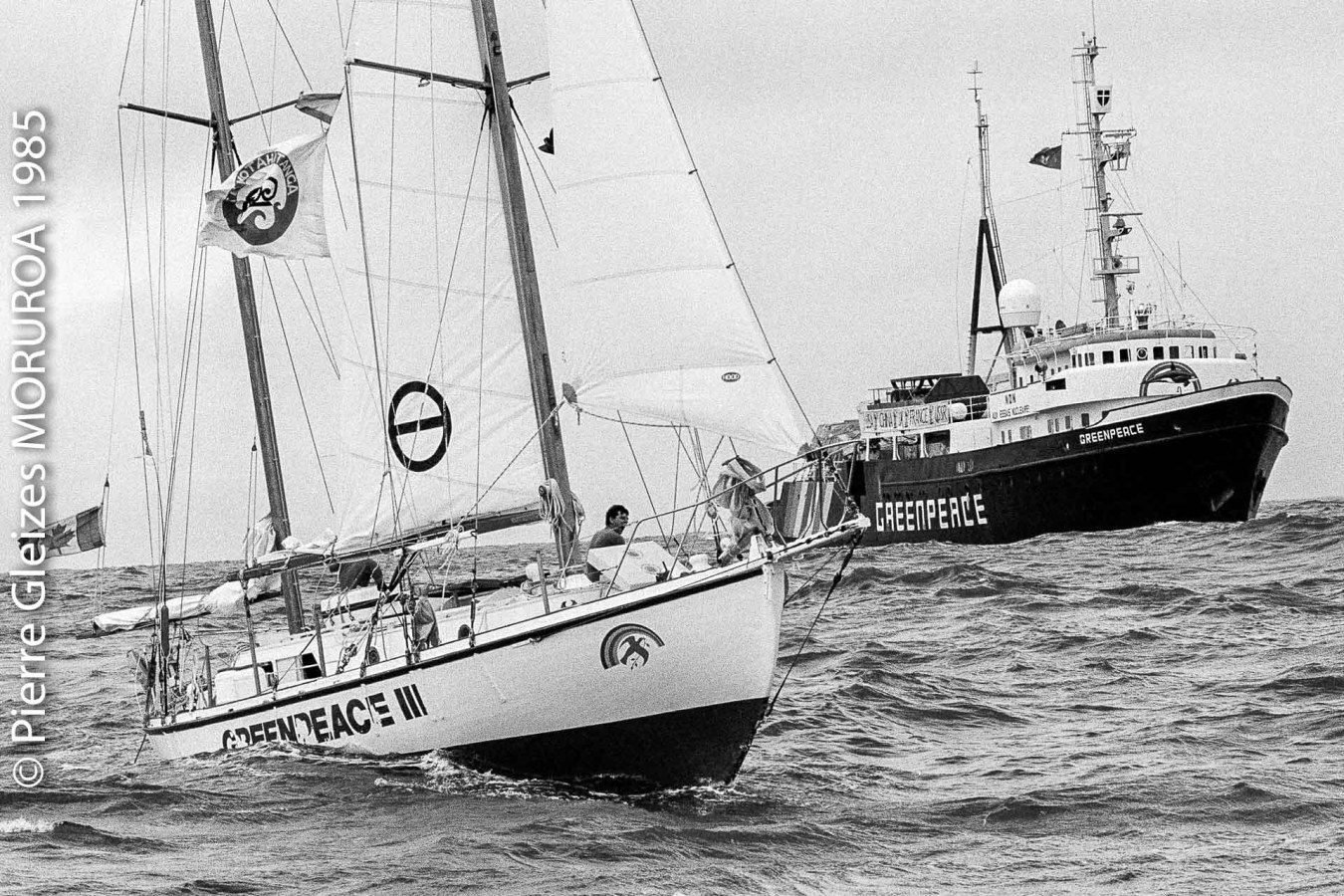 The Vega, left, and the M.V. Greenpeace meet off the atoll of Mururoa to protest French nuclear testing in the South Pacific, Oct. 4, 1985. The Vega, with a crew of 5 from 4 different countries, has been at sea 42 days since leaving New Zealand. The Greenpeace left Amsterdam Aug. 19, replacing the Rainbow Warrior which was sunk by French Secret Service. (AP Photo/Pierre Gleizes)