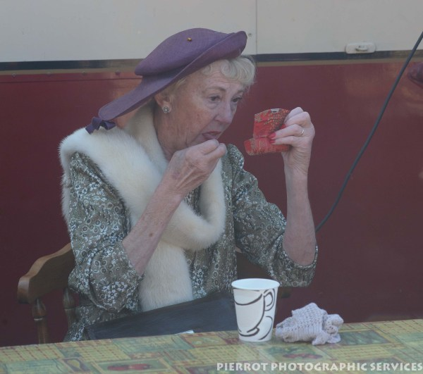 Pretty older woman adding makeup at the 1940s weekend at Sheringham 2012