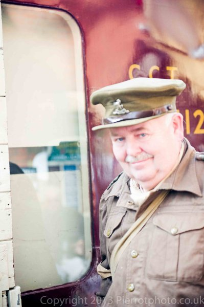 Army officer by railway carriage