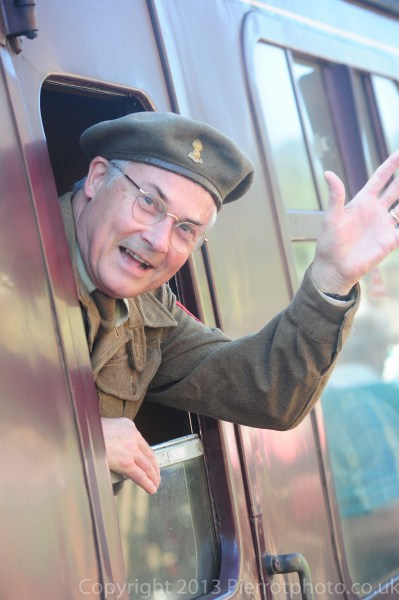 Soldier waving goodbye from train