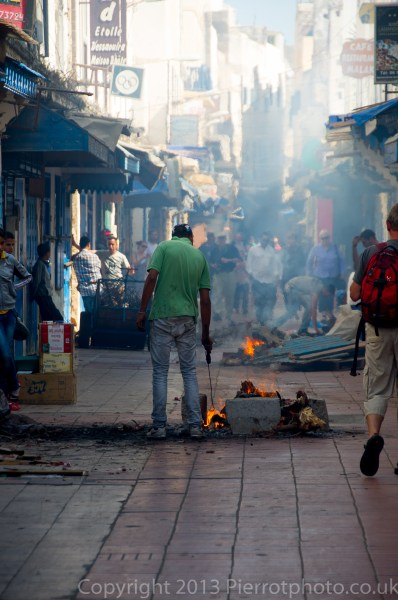 Slaughtered sheeps' heads and bones being burnt, during the festival of Eid al Ahad, in the medina in Essaouira,