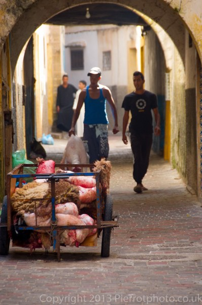 Slaughtered sheepskins in a trolley, during the festival of Eid al Ahad, in the medina in Essaouira, Morocco