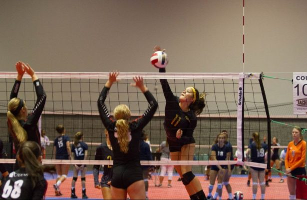 Tiani Bello #11 hits over the block at the 43rd Annual AAU National Championship.