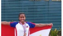 Zion proudly displaying the flag after winning 2 sprint medals for the Philippines in her first race.