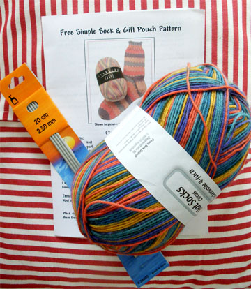 yarn, needles and sock pattern