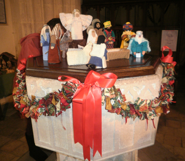 Church Font decorated with Christmas Swags