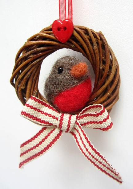 needlefelt robin in a twig wreath
