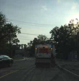 A sweeper truck cleans University Place just after 7 a.m. Monday, July 6.