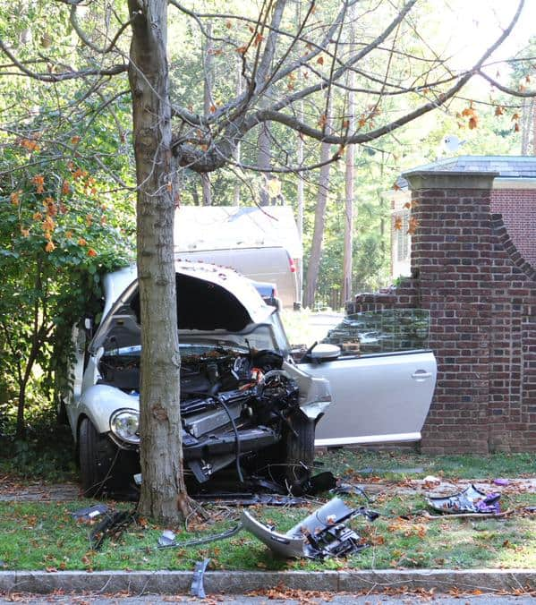 A car crashed into a brick wall on Library place just before 10 a.m. Photo: Seth Callen.