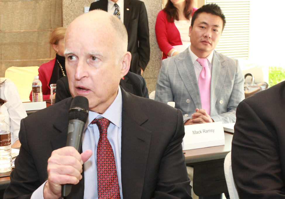 Governor Brown offers comments at the Shanghai forum. In the background is Peter Huo, in-country representative for Wine Institute.
