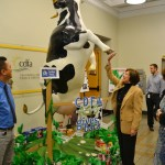 Daisy the cow gets the high hoof from Secretary Ross.