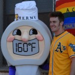 Mark Canha of the Oakland A's poses with food safety mascot Thermy.