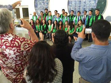 Upcoming graduates of the CSin3 program gathers for a group photo as their family members snap pictures.
