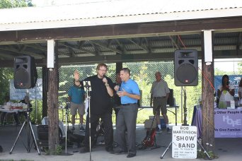Bob Martinson and County Executive Marc Molinaro sing for the Seniors