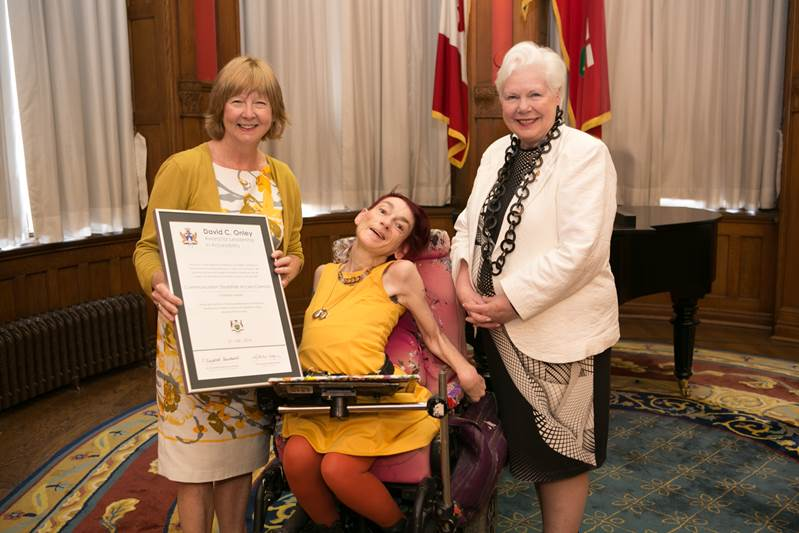 This is a photograph of Barb Collier, the Executive Director of Communication Disabilities Access Canada, Anne Abbott, and Lieutenant Governor Elizabeth Dowdeswell.