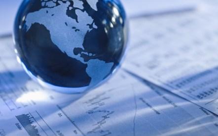 Globe over financial data sheets