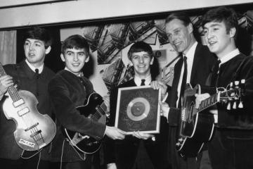 The Beatles in 1963 with their first silver record. From left: Paul McCartney, George Harrison, Ringo Starr, producer George Martin and John Lennon.