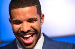 Rapper Drake smiles during an announcement that the Toronto Raptors will host the NBA All-Star game in Toronto, September 30, 2013. Toronto was selected as the host of the National Basketball Association's (NBA) 2016 All-Star Game, marking the first time the showcase event will be held outside of the United States, the league said on Monday. REUTERS/Mark Blinch (CANADA - Tags: SPORT BASKETBALL ENTERTAINMENT) - RTR3FG0W
