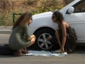 female-changing-tire