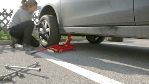 female changing tire