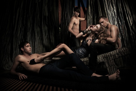 Glamorous woman with three men in potential entanglement