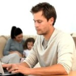 stock-footage-man-working-on-his-laptop-while-his-family-is-on-the-sofa-300x168