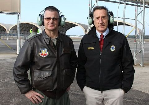 "But wait, isn't there less noise when wearing ear protection? ""Gov. Peter Shumlin and Vermont National Air Guard Brigadier Gen. Steve Cray wait to hear F-35 fighter jet"" at Eglin AFB in FL. Vermont Public Radio / Kirk Carapezza"
