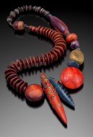 "Loretta Lam, The Red Pod, 22""l  x 3""w  x 3/4"" d, 2013, polymer, coconut shell, wood beads, covered barrel clasp, photo: Doug Yaple"