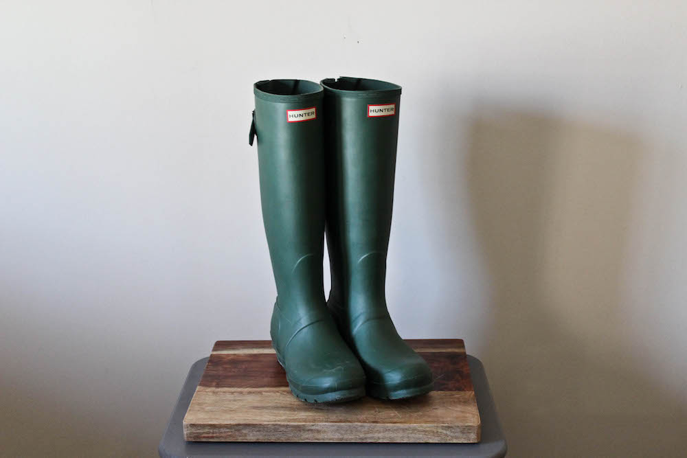 Hunter Rain boots in a winter capsule wardrobe.
