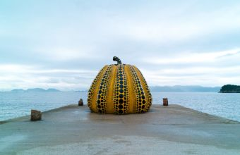 A Yayoi Kusama 'Pumpkin' sits pensively at the end of a jetty at the Benesse Art Site Naoshima in Japan. Image courtesy of Joi Ito
