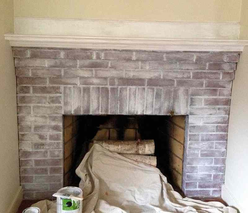 First coat of white wash on fireplace