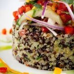 Quinoa salad served with cotija cheese, avocado, and olives