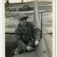 WWII 388th Bomb Group Post - Radio Mechanic Cpl. Roland Downs Fixing a B-17 in Knettishall, England