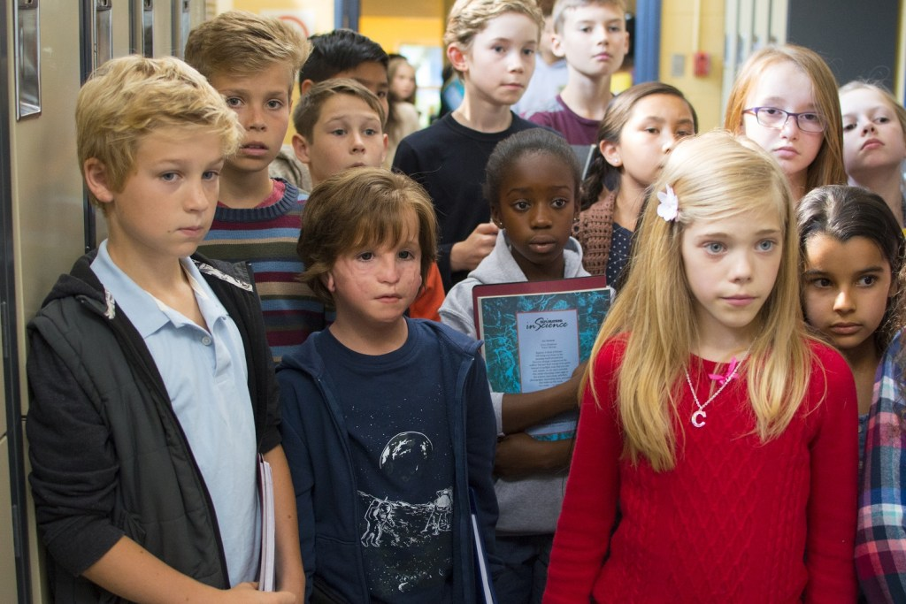 "Jacob Tremblay as ""Auggie"" and Elle McKinnon as ""Charlotte"" in WONDER."