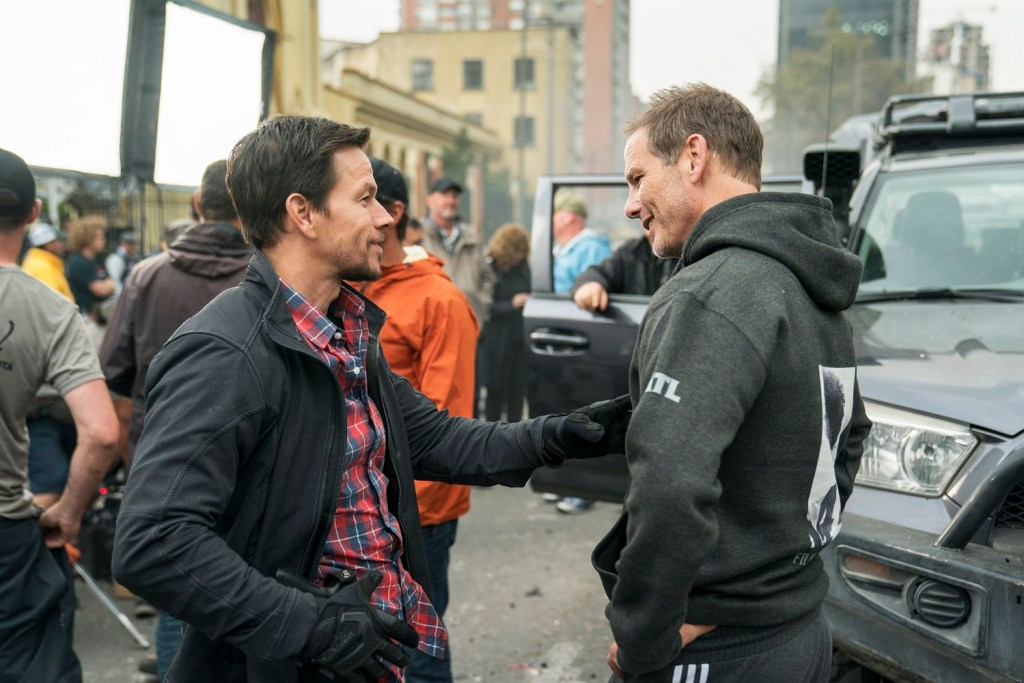Mark Wahlberg and Director Peter Berg behind the scenes on the set of MILE 22.