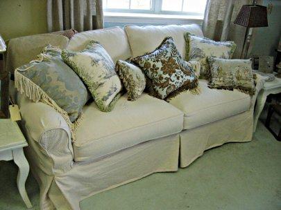 2 cushion sofa with pillows