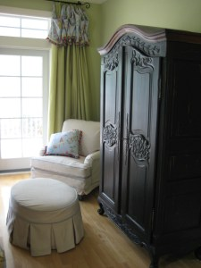 Chinoiserie print linen valance with tassel trim over silk curtains.