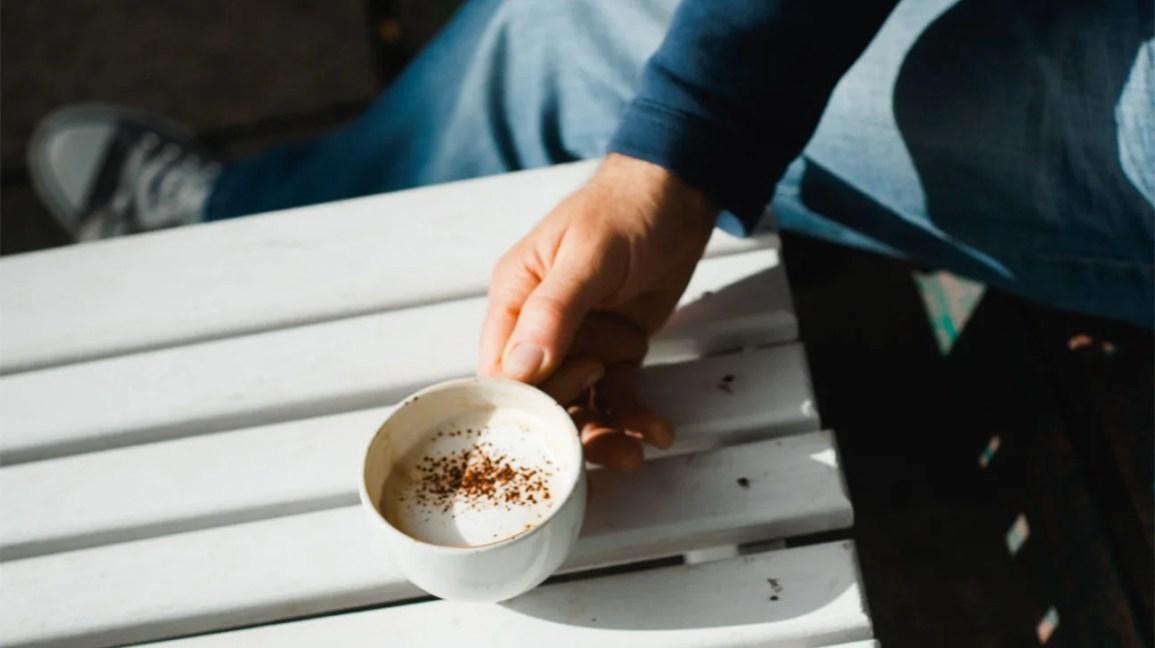 man holding mug of coffee