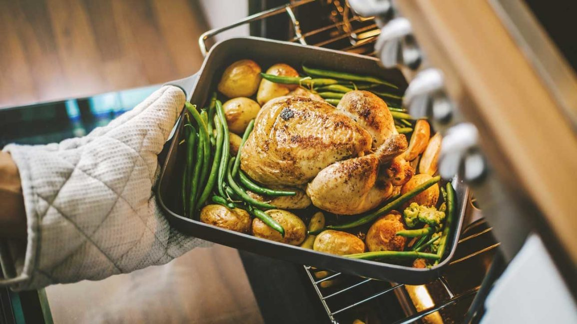 roast chicken, potatoes and green beans coming out of oven
