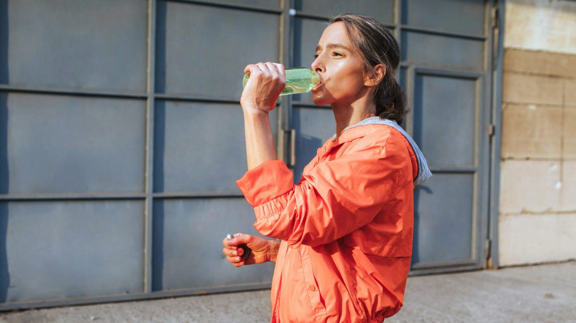 Woman drinking protein water